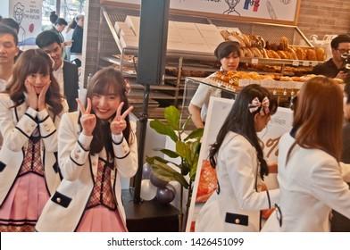 BANGKOK, THAILAND - NOVEMBER 23, 2018: Dusita Kitisarakulcha (Natherine), a member of Thai Idol girl group BNK48, show Victory signs by 2 hands to greet  fanclub in Gontran Cherrier bakery