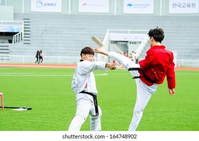 BANGKOK THAILAND - NOVEMBER 23: Unidentified taekwondo man in sporting event at Hanmaeum International Sports Festival 2013 Korean Association of Thailand on NOVEMBER 23, 2013 in Bangkok, Thailand.