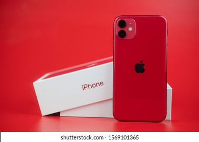 Bangkok, Thailand - November 24, 2019: Apple iPhone 11 PRODUCT RED on a red background. Smartphones from Apple company close-up.