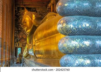 BANGKOK, THAILAND - November, 25, 2008: Reclining buddha at Wat Pho temple. Wat Pho is home to more than one thousand Buddha images.