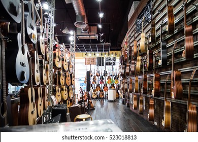 BANGKOK, THAILAND, November 25, 2016: Guitar shop, many guitars background, pop rock artist song music and entertainment instrument.