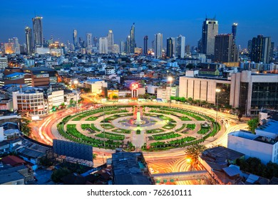 Bangkok / Thailand - November 26, 2017: Capital city of Thailand, Bangkok at twilight. Taken from high building, colorful sky in background. Famous big circle Wong Wean Yai with building in background