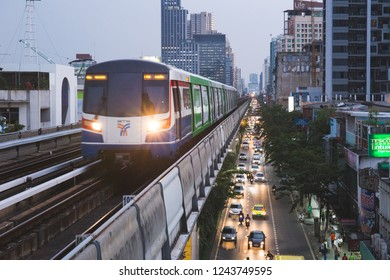 Bangkok, Thailand - November 26 ,2018 : BTS Skytrain runs through the city center above cars at roads. Skytrain is an elevated rapid transport system in Bangkok, Thailand.