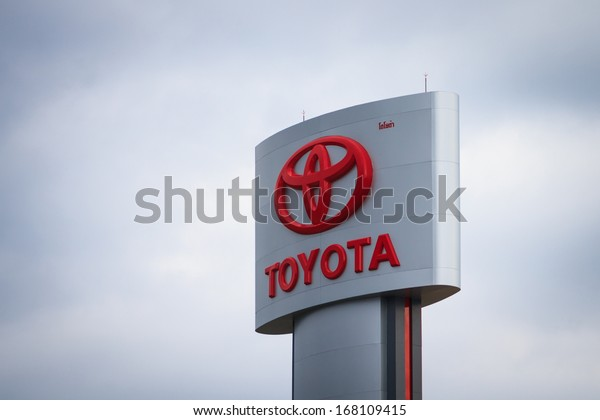 BANGKOK, THAILAND - NOVEMBER 26 : An emblem of Toyota dealer, shot in front  of Toyota dealer Thailand, November 26 2013, Bangkok, Thailand. Toyota Motor Corporation is headquartered in Toyota, Japan