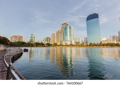 BANGKOK, THAILAND - November 26;2017: The business skyscraper skyline is in Bangkok city downtown with reflection on wide lake in Bangkok.