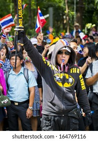 BANGKOK, THAILAND - NOVEMBER 27: Protesters hold an anti-government rally on November 27, 2013 in Ministry of industry's office. They blow whistles to make symbolic protest against the amnesty bill.