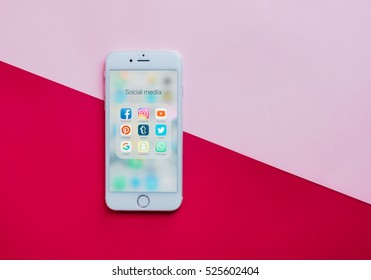 BANGKOK, THAILAND - NOVEMBER 28, 2016:  Group of Popular Social networks icons showing on Apple iPhone 6s screen on pink and red background, Social media are most popular tool for communication.