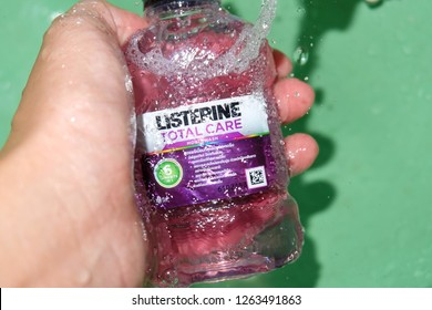 Bangkok, Thailand- November 28, 2018:Listerine Brand.Oral cleaning.Handle mouthwash or gargle.and Water from the sink. tap on the bottle.Refreshing.Fluoride ingredients Help prevent tooth decay