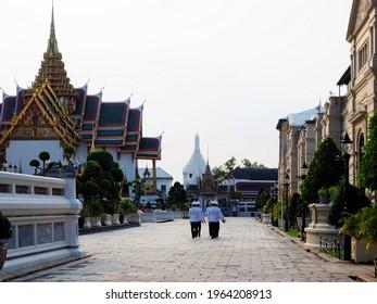 Bangkok, Thailand - November 28 2020: evening at Bangkok grand palace with marching guards in the distance