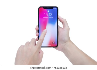 BANGKOK, THAILAND- NOVEMBER 28: Close-Up on Woman Hand Touching The New Iphone X Screen on November 28, 2017