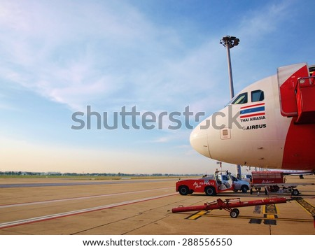 BANGKOK, THAILAND - NOVEMBER 28 : Thai Air Asia Plane parked at Don Mueang International Airport on November 28, 2013 in Bangkok, Thailand. Air Asia company is the largest low cost airlines in Asia.
