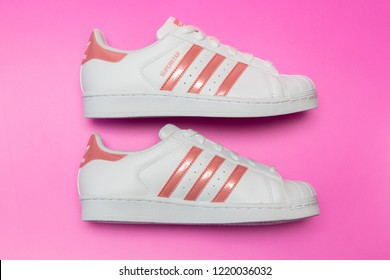 BANGKOK, THAILAND - NOVEMBER 3, 2018 : Adidas superstar J white/pink shoes with popular fashion for women in Thailand.