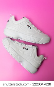 BANGKOK, THAILAND - NOVEMBER 3, 2018  : Fila shoe, model disruptor 2 white popular, Fila is one of the world's largest sportswear manufacturing companies. Studio shot, isolated on pink background.
