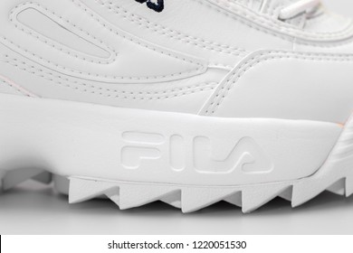 BANGKOK, THAILAND - NOVEMBER 3, 2018  : Fila shoe, model disruptor 2 white popular, Fila is one of the world's largest sportswear manufacturing companies. Studio shot, isolated on white background.