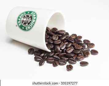 Bangkok ,Thailand - November 4, 2015 : Studio still life photography of Starbucks coffee cup with coffee bean on white background.