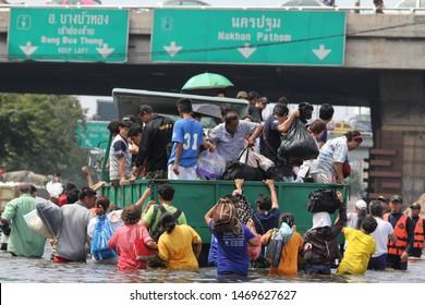BANGKOK, THAILAND - November 5, 2011 - Victims on commercial vehicles in massive floods at Bang Khae district, Bangkok, Thailand on November 5, 2011