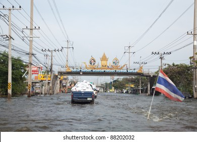 BANGKOK THAILAND - NOVEMBER 5 : Vehicles transport food supplies to help people impacted from flooding, in Pathumtani, Thailand on November 5, 2011