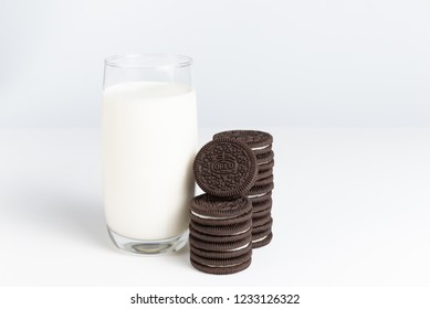BANGKOK, Thailand - November 6, 2018: OREO cookies in stack with glass of fresh milk on white background (American famous cookie brand)