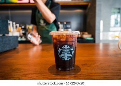 Bangkok , Thailand  Oct 09 2019: A tall ice Amarciano coffee Starbucks coffee in starbucks coffee shop. Starbucks is the world's largest coffee house with over 20,000 stores in 61 countries.