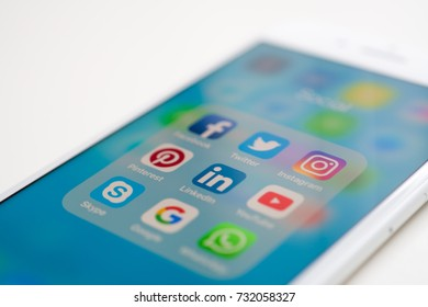 Bangkok, Thailand - OCT 11, 2017: using white Iphone7 Plus with icon social media on screen smartphone marketing communication business and technology background digital share network app editorial