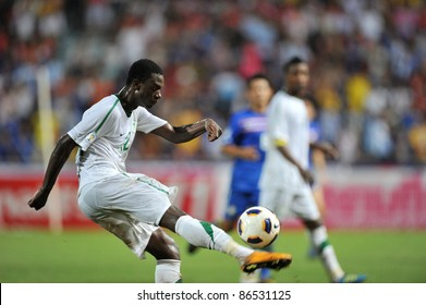 BANGKOK THAILAND - OCT 11: M.Hassan of Sa in action during FIFA WORLD CUP 2014 between Thailand(B) and Saudi Arabia(W) at Rajamangla Stadium on Oct 11, 2011 Bangkok, Thailand.