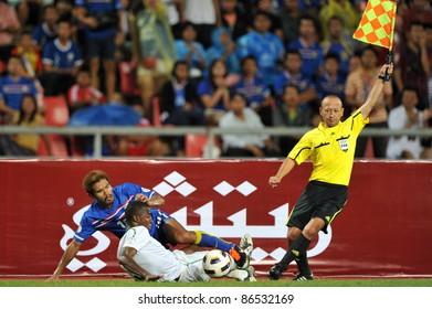 BANGKOK THAILAND - OCT 11: Suree Sukha of Thailand in action during FIFA WORLD CUP 2014 between Thailand(B) and Saudi Arabia(W) at Rajamangla Stadium on Oct 11, 2011 Bangkok, Thailand.
