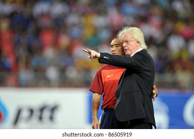 BANGKOK THAILAND - OCT 11: Winfried Schafer Coach of Thailand in action during FIFA WORLD CUP 2014 between Thailand(B) and Saudi Arabia(W) at Rajamangla Stadium on Oct 11, 2011 Bangkok, Thailand.