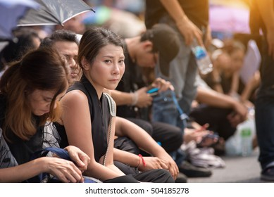 Bangkok, Thailand -OCT 14 2016: A crowd of mourners at Sanam Luang, while the body of Thailand Bhumibol Adulyadej is taken from the hospital to the Temple of the Emerald Buddha in Bangkok.
