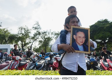 BANGKOK, THAILAND - Oct 14,2016 : Thai people hold the portrait of King Bhumibol Adulyadej during a convoy carrying the body of the King from Siriraj Hospita to the Royal Palace on October 14,2016.