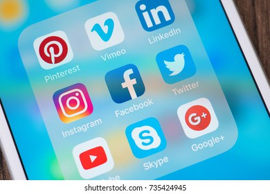 Bangkok, Thailand - OCT 16, 2017 : social media app on screen modern smart phone white Iphone 7 Plus with icon on blue screen, business technology mobile phone marketing share concept editorial
