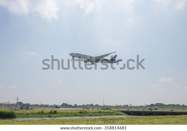 Bangkok, Thailand Oct 17 2015 : Thai Airways aircraft during landing at the Suvarnabhumi international airport in Bangkok Thailand.