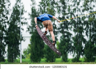 Bangkok, Thailand - OCT 2018 : Wakeboarding is a surface water sport which involves riding a wakeboard over the surface of a body of water. It's use more energy of body to control.