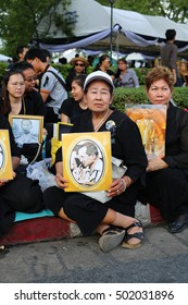 Bangkok, Thailand- OCT 21, 2016: The people hold the portrait of King Bhumibol Adulyadej at Sanam Luang in front of the Royal Palace to pay respect for the king on OCT 21, 2016 Bangkok Thailand.