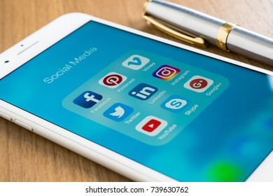 Bangkok, Thailand - OCT 22, 20147 : social media icon market background for business network mobile smart phone share app and logo closeup white iphone 7 plus editorial