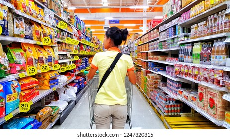 BANGKOK, THAILAND – Oct 23, 2018 : Women are shopping in supermarket. shopping, consumerism and people concept - woman with food cart  at grocery store or supermarket.