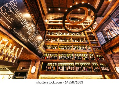 BANGKOK, THAILAND. OCT 31, 2016: Wine cellar on the wall in Italian restaurant decorated with brick in warm light that created cozy atmosphere.