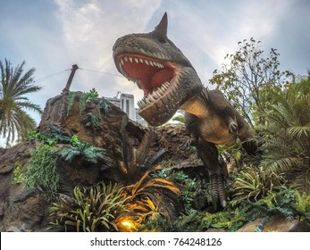 Bangkok, Thailand - Oct 5 2017 : Feature of a tropical city scene with Carnotaurus illustrated in the new hunting ground displayed at Dinosaur's Planet, Bangkok, city center.