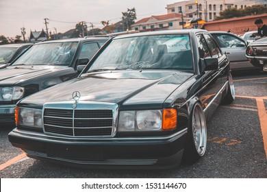 BANGKOK, THAILAND - OCT 6, 2019: The Mercedes-Benz 190E (W201) parking at train market srinakarin on street.