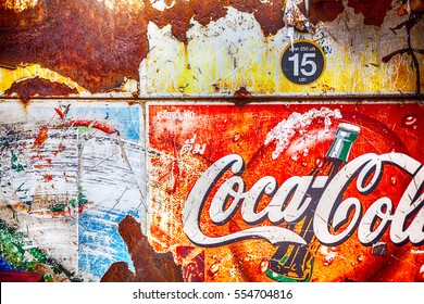 Bangkok, Thailand - Octobed 02, 2016 : Grunge rusty retro vintage Coca-Cola advertising metal board sign