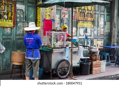 BANGKOK, THAILAND - OCTOBER 04: Street food vendor in the street bazaar back lane on September 04, 2012 in Bangkok, Thailand. Vendor waits for customers.