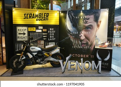 Bangkok, Thailand - October 06, 2018: Standee with a Ducati Scrambler Motorcycle and a Motorcycle Helmet of Movie VENOM (Black Danger Enemy Creature from Spiderman Movie) display at the theater