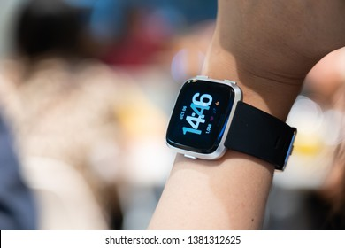 BANGKOK - THAILAND - OCTOBER 06 2018 : View of Fitbit Versa wearing on women wrist, Bangkok, Thailand on October 06,2018.