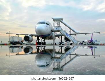 Bangkok Thailand October 07 2014:Bangkok Airways A319 parking before departure after rain in the morning at Suvanabhumi Airport.