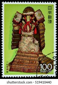 """BANGKOK, THAILAND - OCTOBER 08, 2016: A postage stamp printed in Japan shows Kozakura Rui armor strength samurai suite, series """"3rd National Treasure """", circa 1987."""