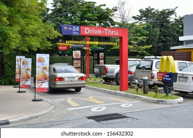 Bangkok, Thailand - October 1, 2013: Unidentified customer driving into McDonald's drive thru lane service on 1 October 2013 at The Circle, Ratchapruk road, Bangkok
