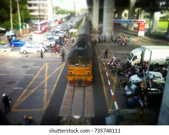 Bangkok, Thailand, October 10, 2014: The image of a driver on the road waiting for the train to pass. The police are taking care.