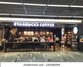 Bangkok, Thailand - October 10, 2018 : Starbucks coffee cafe with many customers inside at the airport