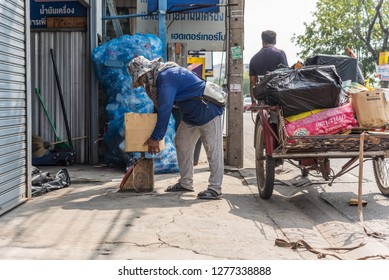 Bangkok, Thailand - October 10, 2018 : Unidentified asian man buying antiques or unused items freight by Freight Tricycles (Saleng, Zaleng) for recycle to sell