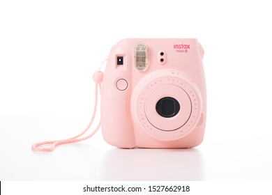 BANGKOK, THAILAND - OCTOBER 10, 2019: The pink Fujifilm Instax mini 8 instant camera over background.
