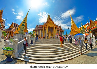 Bangkok, Thailand - October 11, 2014: The Prasat Phra Thep Bidon, part of the Wat Phra Kaew in the Grand Palace area, with visitors on the parvis and on the steps.